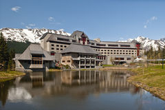Alyeska Resort Hotel. Landscape view of the Alyeska resort lodge hotel set in the Seven Glaciers mountain range in Girdwood, Alaska (USA royalty free stock photography