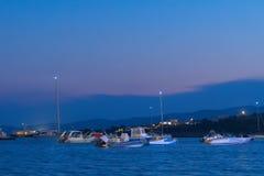 Alyki port in Paros island full of motor boats and fish boats. Royalty Free Stock Photos