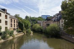 Alzette river with houses in Luxembourg from street. Alzette river with houses in Luxembourg from Rue Munster street stock images