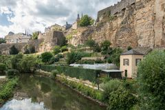 Alzette river Luxembourg city downtown Grund with fortifications and gardens. Alzette river Luxembourg city downtown Grund with medieval fortifications and royalty free stock photos