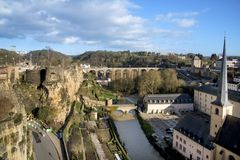 Alzette River and in Luxembourg City, Luxembourg. The Alzette River in Luxembourg City, Luxembourg, highlighting the Neumunster Abbey and the Saint-Jean-du-Grund Royalty Free Stock Photography