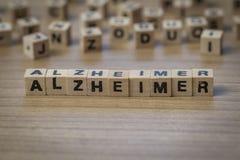 Alzheimer escrito em cubos de madeira Fotos de Stock