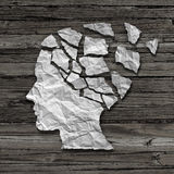 Alzheimer Patient. Medical mental health care concept as a sheet of torn crumpled white paper shaped as a side profile of a human face on an old grungy wood royalty free illustration