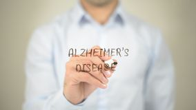 Alzheimer's Disease,  Man writing on transparent screen Stock Image