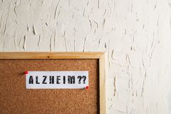 Alzheimer Text on Cork Board. White Wall Royalty Free Stock Images