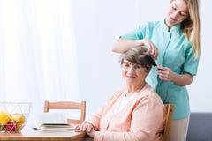 Alzheimer woman and carer. Photo of alzheimer elderly women and carer stock image