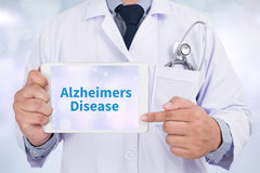 Alzheimers Disease concept. Doctor holding digital tablet royalty free stock photos