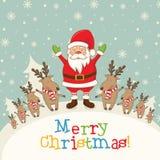 Aménagez en parc avec Santa Claus et des cerfs communs, des cadeaux et des flocons de neige Photos libres de droits