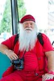 Américain Santa Claus dans le costume rouge d'été Photographie stock