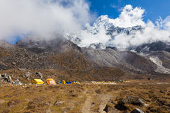 Ama Dablam mountain base camp expedition mountaineers tents. Ama Dablam mountain base camp mountaineers alpinists expedition tents, mountain snow peak glacier stock image