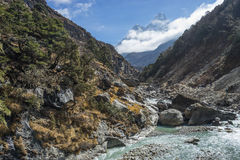 Ama Dablam mountain peak and small river, Everest region, Nepal Stock Images