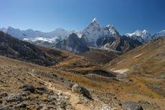 Ama Dablam mountain peak and trekking trail from Kongma la pass Stock Photography