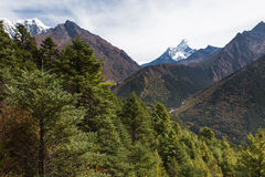 Ama Dablam mountain peaks and deep river canyon. Stock Images