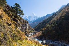 Ama Dablam mountain snow peaks, Imja Khola gorge canyon river. Stock Images