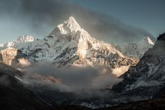 Ama Dablam mountain. Sun illuminates slopes. Himalayan mountains, Nepal. Royalty Free Stock Image