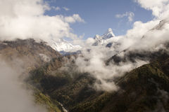 Ama Dablam - Nepal. The trail from Namche Bazar to Phunki Tenga, Nepal. You can see Ama Dablam to the right and in the middle Nuptse, Lhotse, and Everest emerge Royalty Free Stock Photo