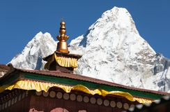 Ama Dablam from pangboche monastery. Buddhist Temple - pangboche monastery - detail of roof with mount Ama Dablam - Nepal Stock Photography