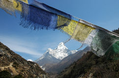 Ama-Dablam and prayer flags. Mount Ama-Dablam in the Himalaya Stock Photos