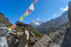 Ama Dablam with stack stone and prayer flag Stock Photos
