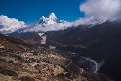 Ama Dablam summit or peak and Nepalese village in Himalayas Stock Photos