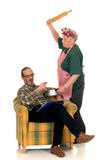 Ama de casa con el marido perezoso Foto de archivo