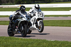 AMA Pro Road Racing:  August 02 Tornado Nationals. Riders, Josh Graham and Aaron Yates, fight for position during the running of the Tornado Nationals presented Royalty Free Stock Image