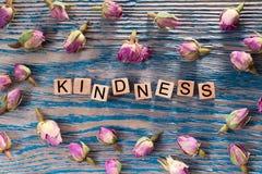 Amabilidad en el cubo de madera imagen de archivo