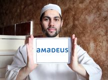 Amadeus IT Group logo. Logo of Amadeus IT Group on samsung tablet holded by arab muslim man. Amadeus is a major Spanish IT Provider for the global travel and Royalty Free Stock Image