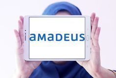 Amadeus IT Group logo. Logo of Amadeus IT Group on samsung tablet holded by arab muslim woman. Amadeus is a major Spanish IT Provider for the global travel and Royalty Free Stock Photos