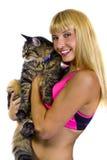 Amaestrador de la aptitud y un gato gordo Imágenes de archivo libres de regalías
