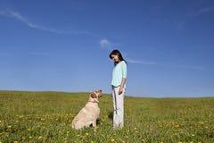 Amaestrador de perro Imagen de archivo libre de regalías