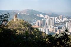 Amahrots, met de nieuwe stad van Shatin op de achtergrond, in Lion Rock Stock Foto