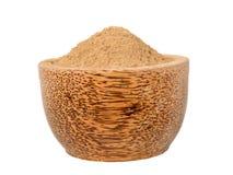 Amalaki powder in the wooden bowl. Amalaki emblica officinalis superfood powder in the wooden bowl isolated on white Royalty Free Stock Image