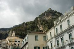 Amalfi cityscapes, Italy. Houses and church on the mountain slope of Amalfi, Italy royalty free stock images