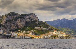 Amalfi coast Costiera Amalfitana:panoramic view of Positano town.Italy Campania. In the background the beach and the tourist port Stock Images