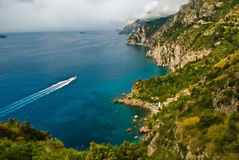 Amalfi Coast of Italy With Boat. The Amalfi Coast is the stretch of coastline on the southern side of the Sorrentine Peninsula of Italy, the Province of Salerno royalty free stock image