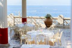 Amalfi coast, Italy. Dinner table and chairs near sea, Beautiful details of Amalfitana at summer, Amalfi coast Italy Royalty Free Stock Image