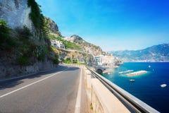 Amalfi coast, Italy. Picturesque winding road of Amalfi summer coastand Tyrrhenian sea with boats, Italy, toned image Stock Photography
