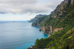 Amalfi Coast. Magically suspended between the blue sky and the iridescent colored sea, the Amalfi coast seems to be born from the palette of a painter who wanted royalty free stock photo