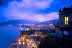 Amalfi Coast Night. Beautiful night view of Italy`s Amalfi coast lit up at night from Sorrento towards Naples Stock Images