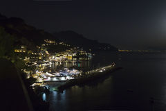 Amalfi Coast by night. Amalfi, Italy: The Amalfi Coast (Italian: Costiera Amalfitana) is a stretch of coastline on the southern coast of the Sorrentine Peninsula Stock Image