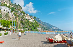 On Amalfi Coast. POSITANO, ITALY - OCTOBER 5, 2012: The walk along Marina Grande, lying at the foot of the steep rock with villas and hotels, cafes and stock photo