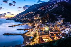 Amalfi coast Salerno, Positano, Campania, Italy. Night city view at sunset. Illuminated Amalfi city panorama view at mediterranean sunset, Salerno Campania Stock Photo