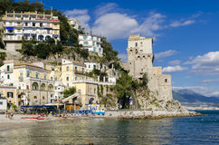 Amalfi Coast from sea. Cetara, Italy - October 2, 2013: Cetara small beach village on the Amalfi Coast, LA beach is defended by an ancient Saracen tower royalty free stock images