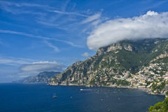 Amalfi Coast, Southern Italy. The dramatic, rugged countryside and cliffs of the Amalfi Coast, on a blue sky day with billowy clouds,  on the Tyrrhenian Sea, a Royalty Free Stock Photos