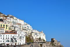 Cliff side village homes and sea of the Amalfi coast in Italy. Amalfi, Italy - March 29 2017: Cliff side village homes and sea of the Amalfi coast in Italy stock image