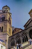 AMALFI, ITALY, 1974 - Tourists walk the staircase to the 9th century Amalfi Cathedral dedicated to St Andrew on a summer day on royalty free stock image