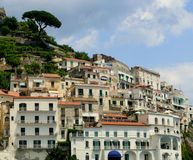 Amalfi terrace houses view. White stone buidings in south Italy. Positano region town from coastline Stock Images