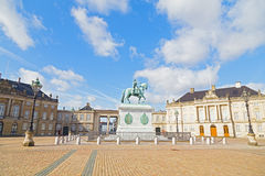 Amalienborg Palace with an octagonal courtyard square and statue in Copenhagen, Denmark. Royalty Free Stock Photos