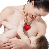 Amamentação da mãe Imagens de Stock